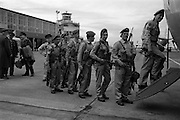 09/04/1964<br /> 04/09/1964<br /> 09 April 1964<br /> Irish U.N. advance party leave for Cyprus. An advance party of 60 Irish troops of the 40th Battalion leaving Dublin Airport by U.S. Airforce plane for Nicosia Airport, the rest of the unit would fly out two weeks later. Picture shows some of the troops boarding the plane.