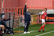 Crawley Town Head Coach John Yems appeals for a throw in during the EFL Sky Bet League 2 match between Cheltenham Town and Crawley Town at Jonny Rocks Stadium, Cheltenham, England on 10 October 2020.