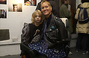 Alison Lapper and her son Parys. AMNESTY INTERNATIONAL EXHIBITION 'IMAGINE A WORLDƒ  WITHOUT VIOLENCE AGAINST WOMEN' Bargehouse Gallery. Oxo Tower. <br />24 November 2005. ONE TIME USE ONLY - DO NOT ARCHIVE  © Copyright Photograph by Dafydd Jones 66 Stockwell Park Rd. London SW9 0DA Tel 020 7733 0108 www.dafjones.com