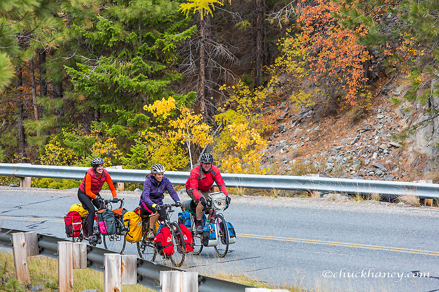 Bike touring in autumn color above Lake Koocanusa in the Kootenai National Forest, Montana, USA model released