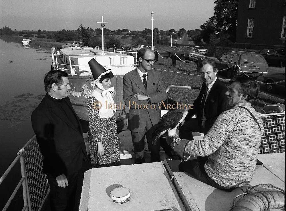Robertstown Grand Canal Festival.(N87)..1981..30.07.1981..07.30.1981..30th July 1981..A reception was held today to announce the launch of the Annual Grand Canal Festival at Robertstown, Co Kildare. The festival features a series of weekend family entertainments in August/September. This years event will be sponsored by Guinness Group Sales, Irl Ltd...At the reception to launch the Robertstown Grand Canal Festival were, Fr Alphonsis Murphy, C C Prosperous, Director, Management Board,Robertstown Muintir na Tire, Ms Moll Fullam,Robertstown Drama Group, Mr John Kinahan, Guinness Marketing Dept, Mr Joe Greevy, Chairman, Festival Committee and Mr Michael Comyns, Falconer with his red tailed hawk on board one of the barges.