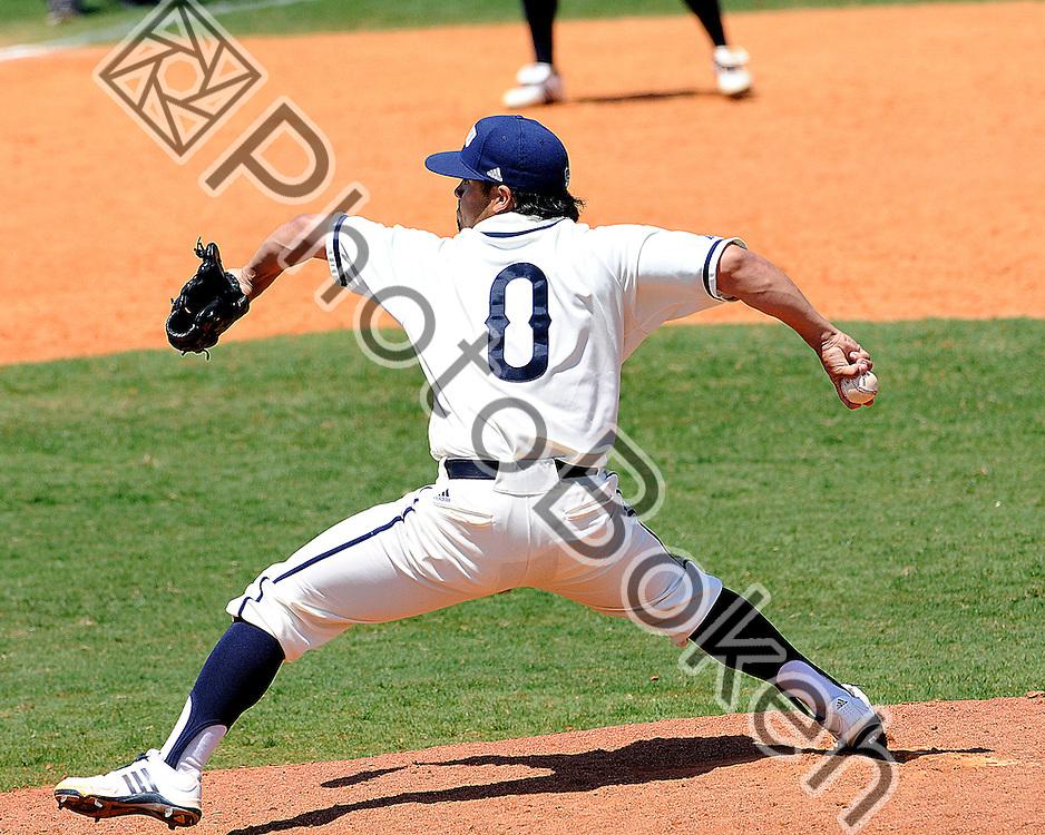 2011 March 3 - FIU Bryam Garcia pitching the ball. Florida International University Golden Panthers Baseball defeated Western Kentucky Hilltoppers, 9-8, in 10 innings at FIU Baseball Stadium, Miami, Florida. (Photo by: www.photobokeh.com / Alex J. Hernandez)