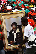 Supporters of the National Union for the Total Independence of Angola (UNITA) hold a Jonas Savimbi picture during a demonstration/rally, held at the Independence Square in Luanda at 25 August.