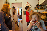 Astrid Hollmann with snacks in her kitchen for her sons and daughter after school in Hamburg, Germany. The family was photographed for the Hungry Planet: What I Eat project with a week's worth of food. Model Released.