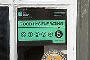 Food Standards Agency hygiene rating sign notice awarding five stars, Suffolk, England, Uk