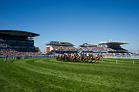 National Hunt Horse Racing - 2017 Randox Grand National Festival - Saturday, Day Three [Grand National Day]<br /> <br />  GV of the grandstands & racecourse The field approaches the bend in the 1st race the 1.45 Gaskells Handicap Hurdle at Aintree Racecourse.<br /> <br /> COLORSPORT/WINSTON BYNORTH