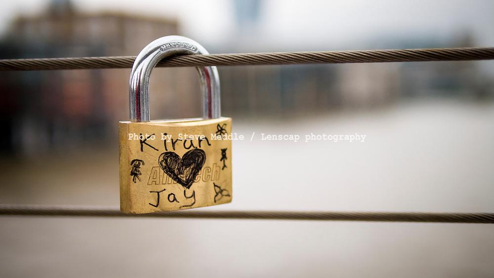 Love Padlock on the Millennium Bridge, London, Britain - Nov 2013.