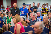 08 SEPTEMBER 2012 - SURPRISE, AZ:    Voters line up to ask questions of Dr. Richard Carmona during a campaign town hall meeting in Surprise, AZ. Carmona, a Democrat, is from Tucson, AZ. He is a former US Surgeon General, former Green Beret, and former SWAT Police officer, is running for the US Senate being vacated by Republican Sen. Jon Kyl. His opponent in the November election is Rep. Jeff Flake, a long serving Congressman from Mesa, a suburb of Phoenix.   PHOTO BY JACK KURTZ