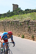cyclist the ruin chateauneuf du pape rhone france
