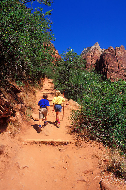 Kids (age 4 & 8) hiking the Emerald Pools trail in Zion Canyon, Zion National Park, Utah