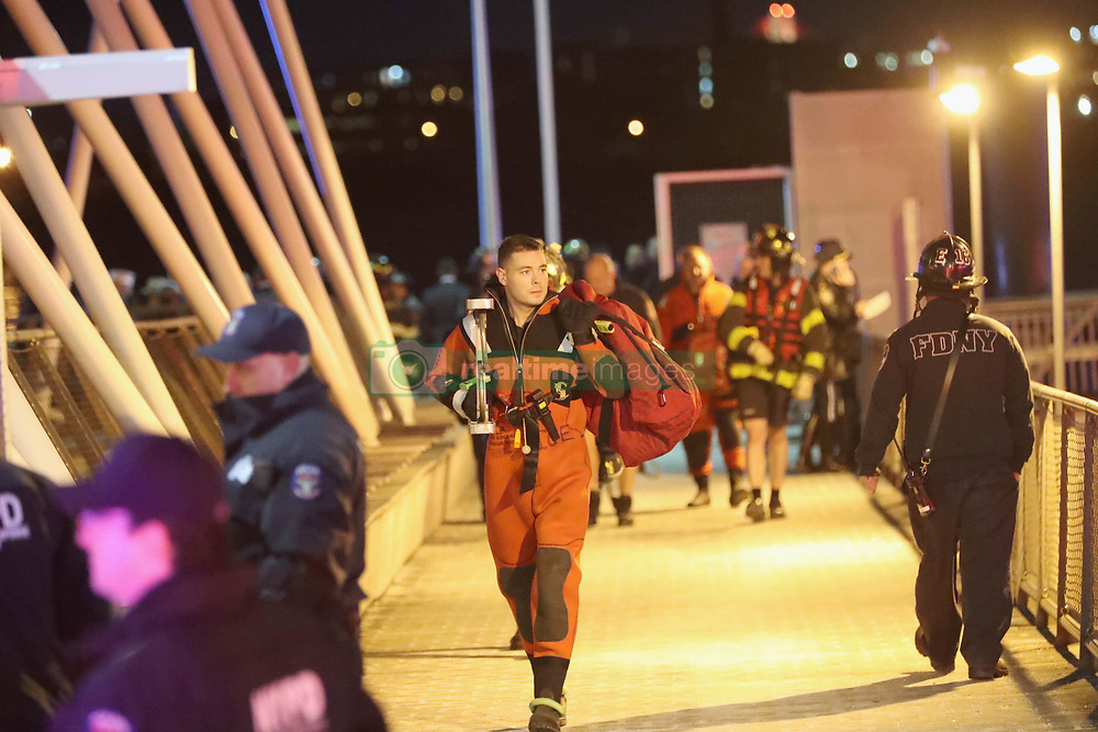 The 5 victims of New York City's deadly helicopter crash are taken from the pier on the East River. ***NO NEW YORK DAILY NEWS, NO NEW YORK TIMES, NO NEWSDAY***. 11 Mar 2018 Pictured: First Responders carry the bodies of the deceased on the pier. Photo credit: G.N.Miller/NYPost / MEGA TheMegaAgency.com +1 888 505 6342