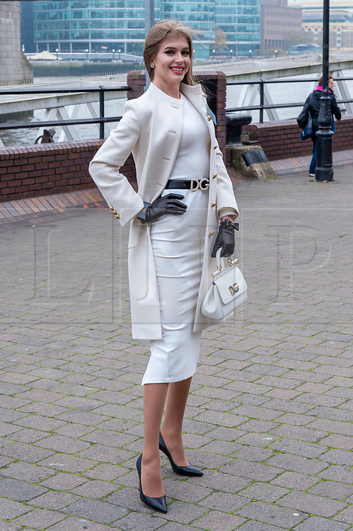 © Licensed to London News Pictures. 21/11/2019. London, UK. Miss Russia (Alina SANKO) pictured at Tower Bridge. National representatives from around the world arrive in London for the 69th Miss World festival and final Photo credit: Peter Manning/LNP