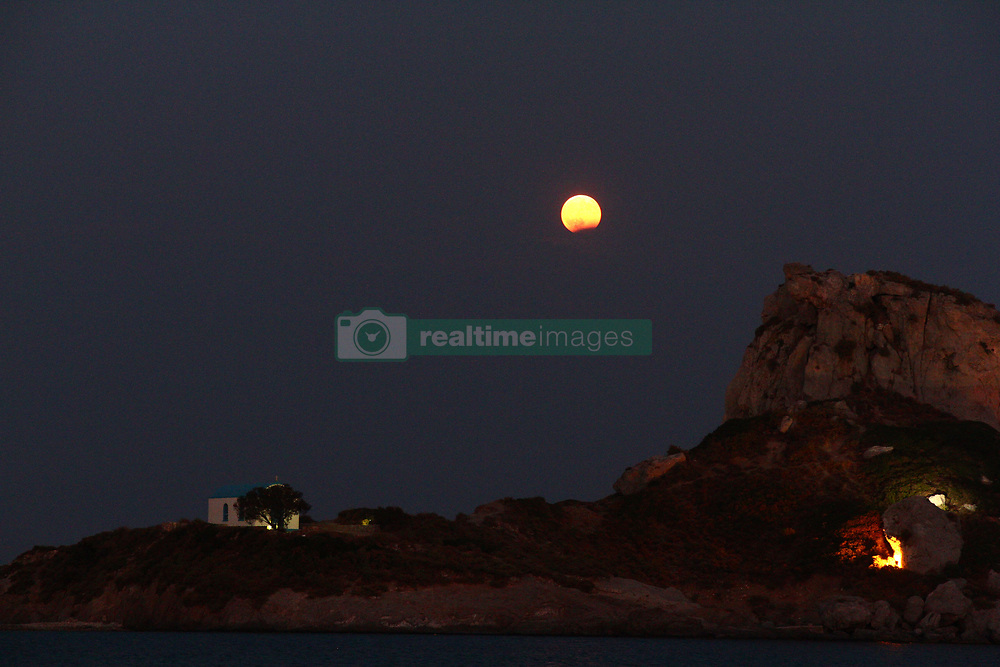 August 7, 2017 - Greece - August full moon is rising over St. Stefanos island in Kos, Greece. (Credit Image: © Kostas Pikoulas/Pacific Press via ZUMA Wire)