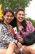 Bilingual Spanish immersion school teachers age 31 riding a Cinco de Mayo float.  St Paul Minnesota USA