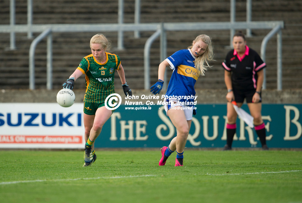 23-07-21. Meath v Tipperary - LGFA All-Ireland Senior Championship - Group 3 Round 2 at O'Moore Park, Portlaoise.<br /> Stacey Grimes, Meath in action against Ellen Moore, Tipperary in the LGFA All-Ireland Senior Championship.<br /> Photo: John Quirke / www.quirke.ie<br /> ©John Quirke Photography, 16 Proudstown Road, Navan. Co. Meath. (info@quirke.ie / 046-9028461 / 087-2579454).