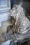 Picture and image of the stone sculpture of Giuseppe Ratto looking down on his grieving wife with an angel in a Borgeois Realistic style. The Ratto Family Tomb sculpted by L Orengo in 1890. Section D no 30 the monumental tombs of the Staglieno Monumental Cemetery, Genoa, Italy .<br /> <br /> Visit our ITALY PHOTO COLLECTION for more   photos of Italy to download or buy as prints https://funkystock.photoshelter.com/gallery-collection/2b-Pictures-Images-of-Italy-Photos-of-Italian-Historic-Landmark-Sites/C0000qxA2zGFjd_k<br /> If you prefer to buy from our ALAMY PHOTO LIBRARY  Collection visit : https://www.alamy.com/portfolio/paul-williams-funkystock/camposanto-di-staglieno-cemetery-genoa.html
