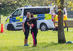 © Licensed to London News Pictures. 16/04/2020. London, UK. A couple exercise on a warm Spring day as Police vans patrol Primrose Hill enforcing lockdown rules on social distancing and exercise. Meanwhile, Pret A Manger and other coffee shops in London start to reopen and Ministers consider when and how the lockdown will finish as politicians are warned that the UK could face the worst recession in 300 years. Photo credit: Alex Lentati/LNP