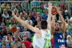 Domen Lorbek of Slovenia and Nicolas Batum of France during last friendly match before Eurobasket 2013 between National teams of Slovenia and France on August 31, 2013 in SRC Stozice, Ljubljana, Slovenia. (Photo by Urban Urbanc / Sportida.com)