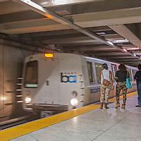 Passengers wait to board a BART (Bay Area Rapid Transit) train near the Embarcadero in San Francisco, California.