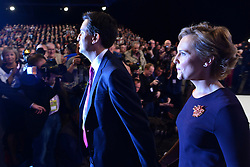 © Licensed to London News Pictures. 02/10/2012. Manchester, UK Ed Miliband, Labour Party leader, leaves the auditorium with his wife Justine, after making his leaders speech on Day 3 at The Labour Party Conference at Manchester Central today 2nd october 2012. Photo credit : Stephen Simpson/LNP