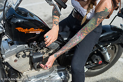 Kissa Von Addams during a stop in while out riding during Daytona Bike Week 75th Anniversary event. FL, USA. Thursday March 3, 2016.  Photography ©2016 Michael Lichter.
