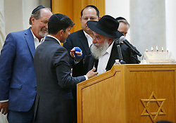 April 29, 2019 - Poway, California, U.S. - OSCAR STEWART, left, who was called a hero in the Poway shooting, is hugged by RABBI YISROEL GOLDSTEIN as Poway Mayor STEVE VAUS, left, looks on during a service for Lori Gilbert-Kaye, 60, at the Chabad of Poway. Gilbert-Kaye was killed by a gunman at the synagogue. (Credit Image: © K.C. Alfred/TNS via ZUMA Wire)