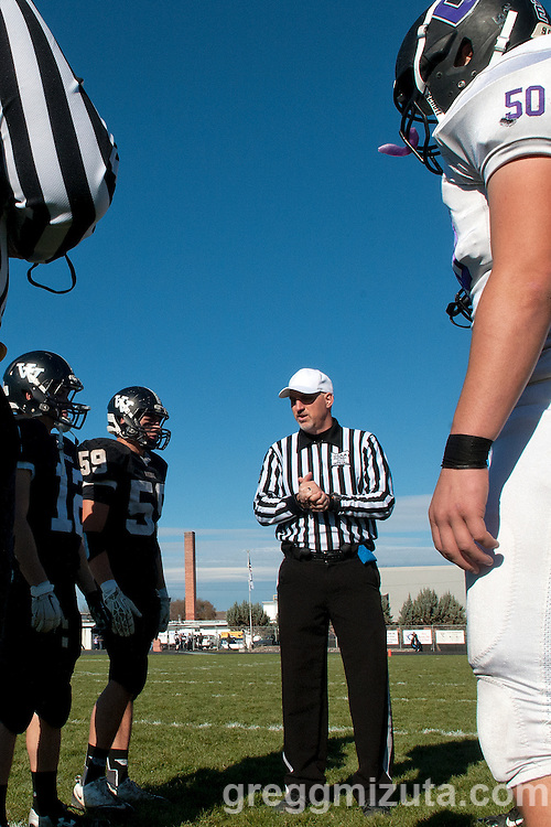 Referee Todd Gorham talks to the team captains before the start of the 3A quarterfinal playoff game at Frank Hawley Stadium, Vale, Oregon, Saturday, November 14, 2015. Vale won 48-38.