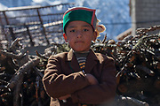 A young boy wearing traditional Kinnauri clothing on 20th October 2009, Himachal Pradesh, India. The region of Spiti and Kinnaur is a remote and tribal area of the Indian Himalayas near the Tibetan border.