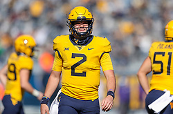 Oct 31, 2020; Morgantown, West Virginia, USA; West Virginia Mountaineers quarterback Jarret Doege (2) smiles after throwing a touchdown during the second quarter against the Kansas State Wildcats at Mountaineer Field at Milan Puskar Stadium. Mandatory Credit: Ben Queen-USA TODAY Sports