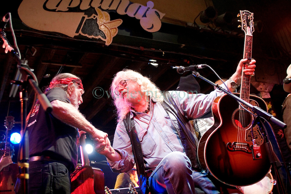 17 December, 05. Tipitina's, New Orleans, Louisiana. <br /> Arlo Guthrie and friends Riding on the city of New Orleans tour benefiting Musicares Hurricane relief 2005 sponsored by Amtrak. (mid) Arlo Guthrie and Willie Nelson (l) wrap up the last concert of the tour.<br /> Photo; ©Charlie Varley/varleypix.com