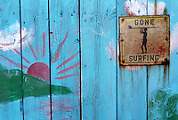 Gone surfing -sign on a blue painted boat house in Hoddevika, Stadt - Blåmalt naust