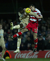 Photo: Aidan Ellis.<br /> Doncaster Rovers v Bristol City. Coca Cola League 1.<br /> 26/11/2005.<br /> Bristol's Baz Savage is beaten to the ball by Doncaster's Stephen Foster