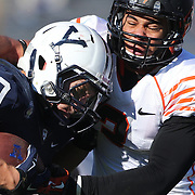 Yale running back Tyler Varga is tackled by Dorian Williams, Princeton, during the Yale Vs Princeton, Ivy League College Football match at Yale Bowl, New Haven, Connecticut, USA. 15th November 2014. Photo Tim Clayton