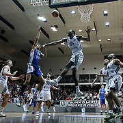 Besiktas integral Forex's Jajuan Johnson (C) and Anadolu Efes's Furkan Korkmaz (2ndL) during their Turkish basketball league match Besiktas integral Forex between Anadolu Efes at BJK Akatlar Arena in Istanbul, Turkey, Monday, January 05, 2015. Photo by TURKPIX