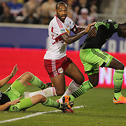 Thierry Henry, New York Red Bulls, is challenged by Osvaldo Alonso, (left), and Jalil Anibaba, Seattle Sounders   during the New York Red Bulls Vs Seattle Sounders, Major League Soccer regular season match at Red Bull Arena, Harrison, New Jersey. USA. 20th September 2014. Photo Tim Clayton