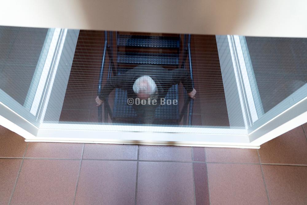senior man walking down the stairs