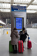 Passengers look at departure times while passing through the main concourse at St. Pancras Station, on 10th April 2018, in London, England.