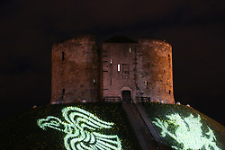 © Licensed to London News Pictures. 20/02/2016. York, UK. Clifford's Tower is lit up with projections during the finale of the annual Jorvik Viking Festival in York, North Yorkshire. The historic city was transformed into a fiery battleground as this year's end to the week long festival told the story of the infamous Battle of Assundun. The festival, which is run by the Jorvik Viking Centre, takes place every February in tradition of an ancient Viking festival known as Jolablot.  Photo credit : Ian Hinchliffe/LNP