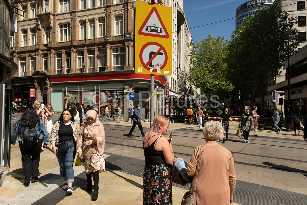 As the coronavirus restrictions continue and the government is about to announce an extension to the original freedom day planned for June, slowing the process of easing, more and more people begin to come to the city centre, seen here at the junction of Corporation Street and New Street on 15th June 2021 in Birmingham, United Kingdom. After months of lockdown, the first signs that life will start to get back to normal continue, with more people enjoying the company of others in public, while uncertainty continues for a projected further month, which is being dubbed The final push.