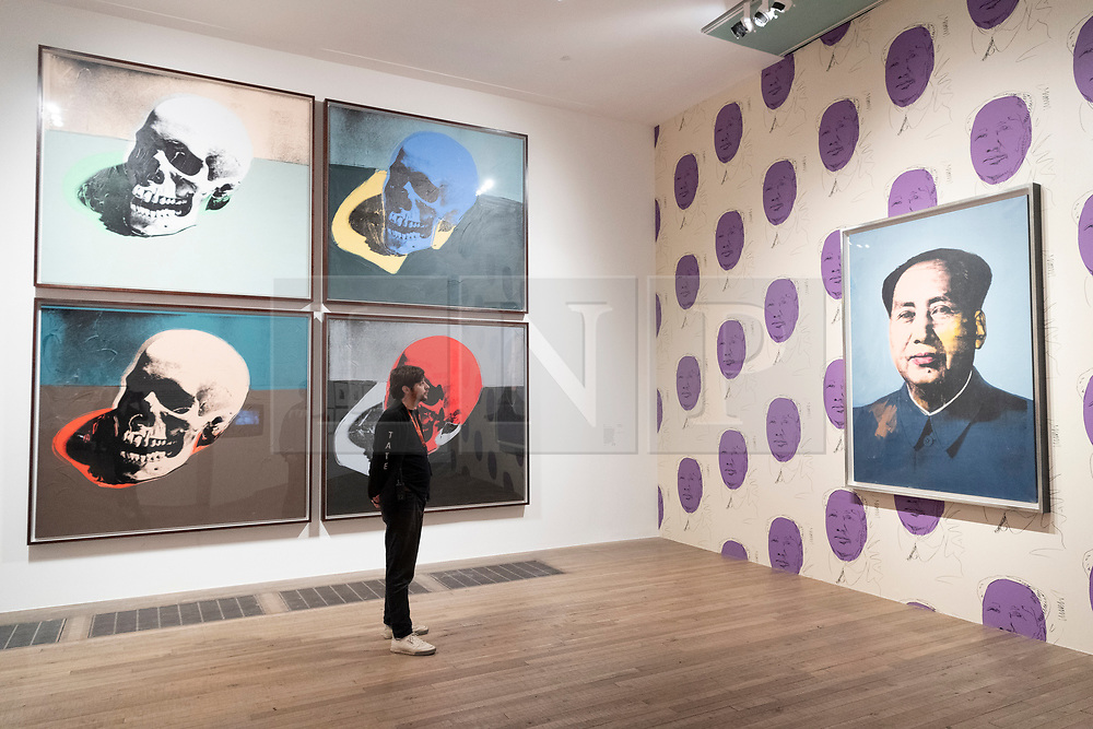 © Licensed to London News Pictures. 10/03/2020. Gallery staff view artwork by artist Andy Warhol at an exhibition showing at the Tate Modern. London, UK. Photo credit: Ray Tang/LNP
