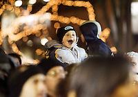 WATERBURY, CT- 25 NOV 2007- 112507JT01- .Jonathan Bytautas, Jr., 3, of Waterbury, cheers as Santa Claus takes the stage on the Waterbury Green Sunday during the annual tree-lighting ceremony..Josalee Thrift / Republican-American