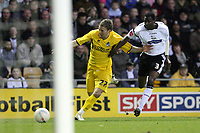 Photo: Pete Lorence.<br />Derby County v Bristol Rovers. The FA Cup. 27/01/2007.<br />Sean Rigg charges past Mo Camara.