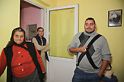 Razvan at his biological family's house in his bedroom, in a village about 15 miles from Ploiesti, north-west of Bucharest. His grand-ma  is on the left, Razvan on the right and one of his sisters' in the back.