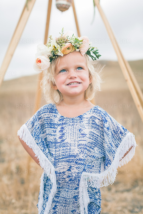 Portrait of adorable toddler outdoors in stylish clothing.
