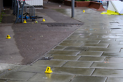 © Licensed to London News Pictures. 21/08/2021. London, UK. Evidence identification markers on the ground at the scene of a fatal stabbing in Kingston. Police were called to a disturbance on Clarence Street at 03:45BST where they found a 22-year-old male with a stab injury to the chest, he was taken to hospital by London Ambulance Service where he was pronounced dead. An 18-year-old male was arrested at the scene on suspicion of murder.Photo credit: Peter Manning/LNP