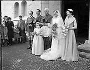 18/11/1952<br /> 11/18/1952<br /> 18 November 1952<br /> Wedding of Lieutenant Seamus Lillis, (son of Colonel James Lillis, Army Chief of Staff) Collins Barracks, Cork and Miss Aureed Mundy, Donegal at Ross Nuala and Bundoran, Co. Donegal. The couple get their picture taken with the Bride's uncle Most Rev. Dr. William MacNeely, Bishop of Raphoe.