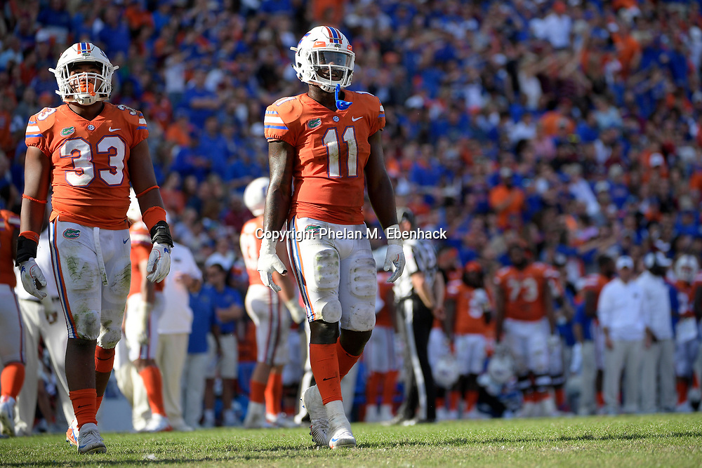 Florida linebacker David Reese (33) and linebacker Vosean Joseph (11) line up for a play during the second half of an NCAA college football game against Florida State Saturday, Nov. 25, 2017, in Gainesville, Fla. FSU won 38-22. (Photo by Phelan M. Ebenhack)