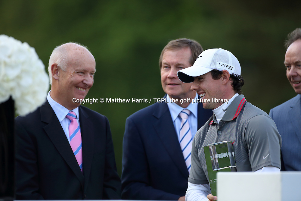Rory MCILROY (NIR) with Tim Abbott of BMW and George O'Grady PGA European Tour right during fourth round BMW PGA Championship 2014,Wentworth West,Wentworth,Virginia Water,Surrey,England.