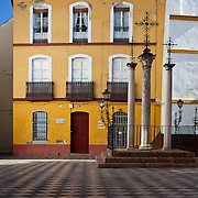 Image of one yellow building in the heart of Seville, Spain.