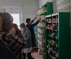 Staff sort through patient medical records in the small polyclinic in the village of Gorodishe, near Lugansk, where MSF are conducting a mobile clinic for the local population.